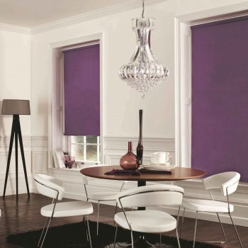 white and purple room with purple roller blinds on the windows