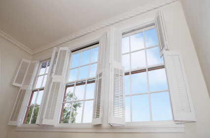 open wooden window shutters