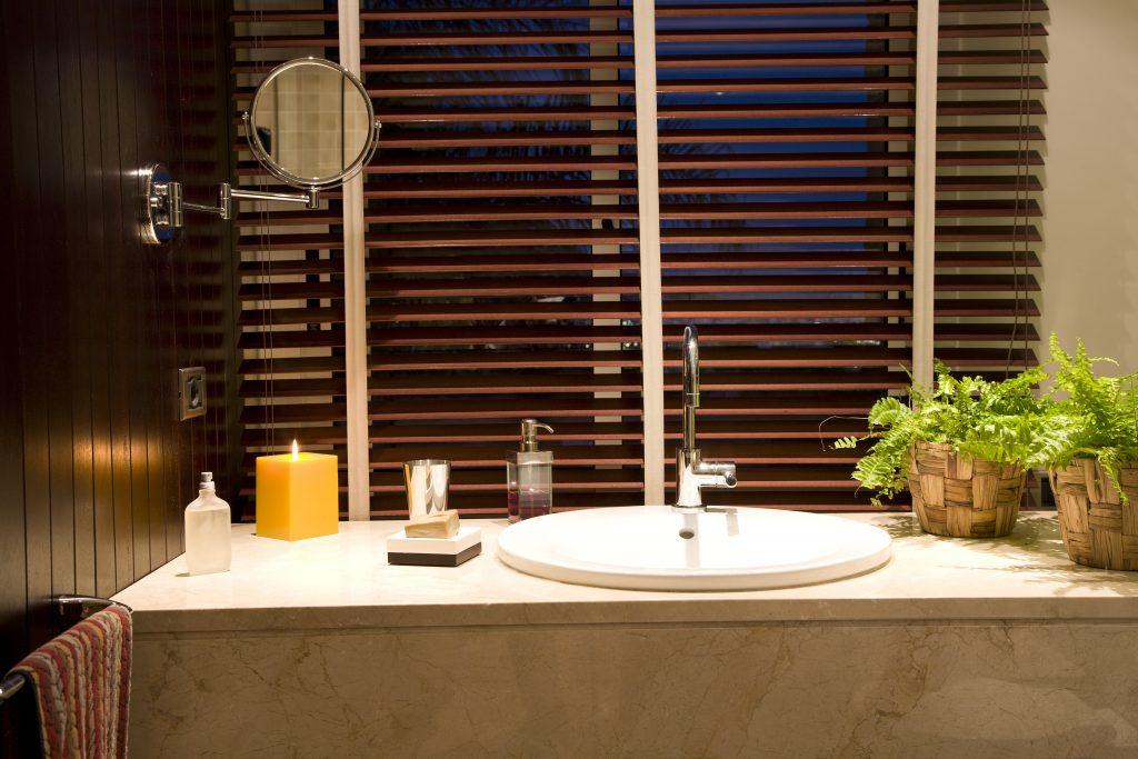 Wooden Venetian blinds in bathroom